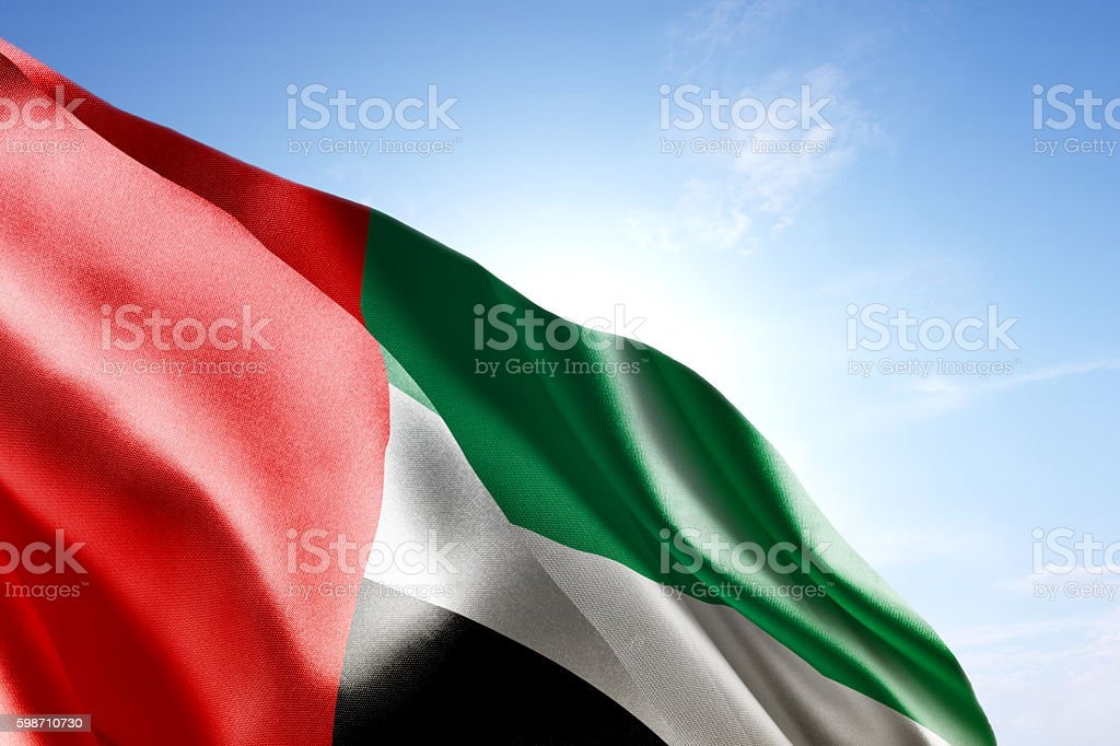 Flag of United Arab Emirates waving in the wind stock photo