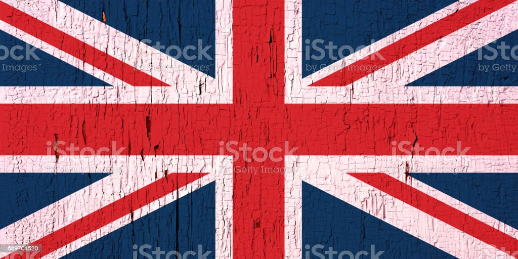 Flag of United Kingdom on peeled, textured, aged paint background stock photo