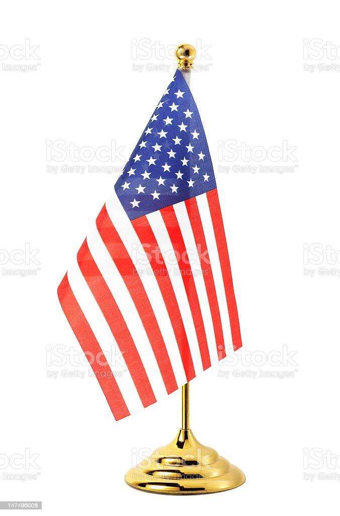 Flag of US hanging on the gold flagpole stock photo