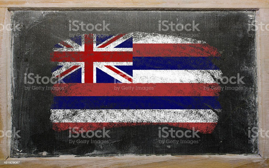 flag of US state hawaii on blackboard painted with chalk stock photo