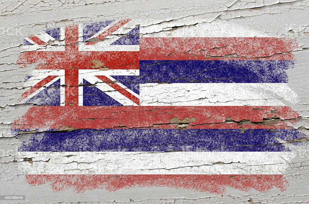flag of US state hawaii on grunge wooden texture stock photo