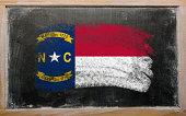flag of US state north carolina on blackboard