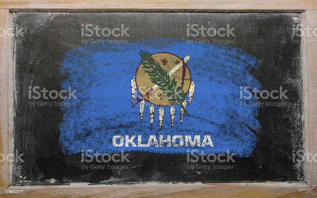 flag of US state oklahoma on blackboard painted with chalk stock photo