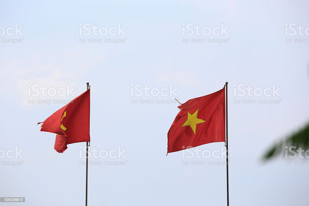 Flag of Vietnam before a blue sky stock photo