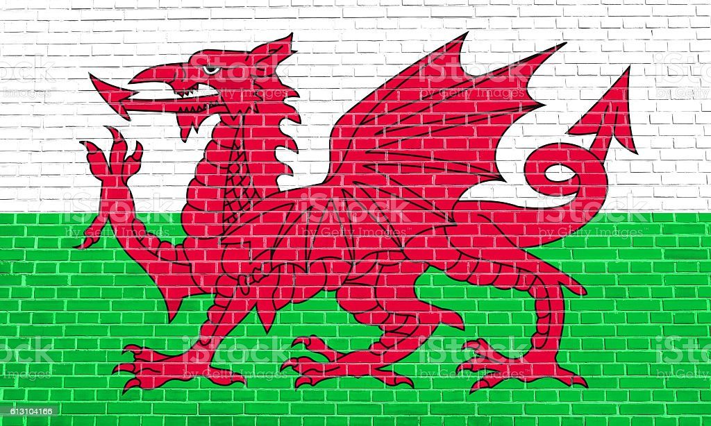 Flag of Wales on brick wall texture background stock photo