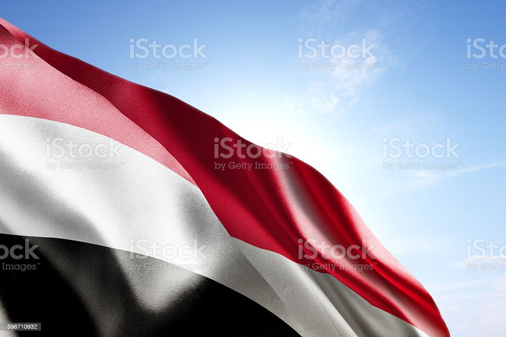 Flag of Yemen waving in the wind stock photo