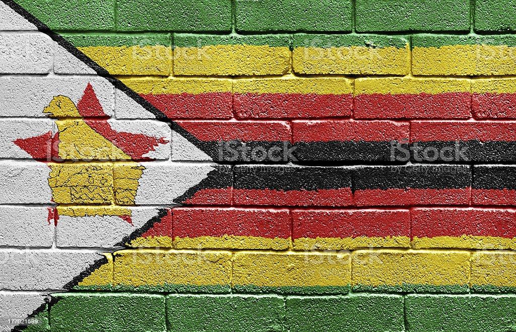 Flag of Zimbabwe on brick wall royalty-free stock photo