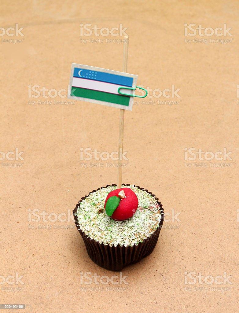 flag on a apple cupcake, uzbekistan stock photo