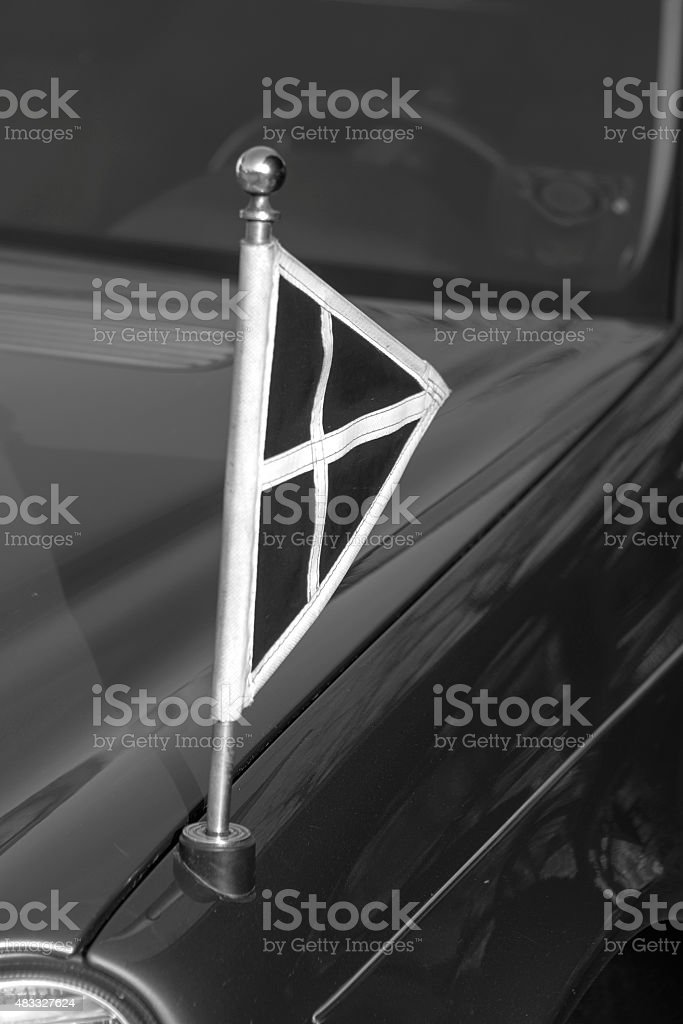 Flag on a  hearse car at a Funeral stock photo