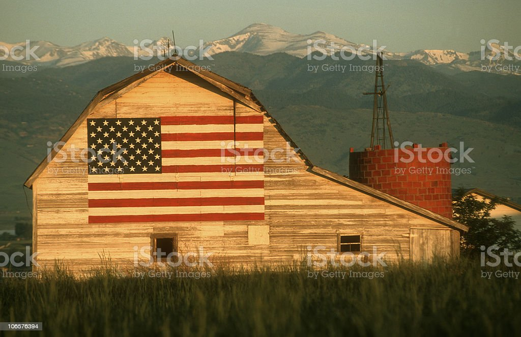 US Flag on an old abandoned barn stock photo