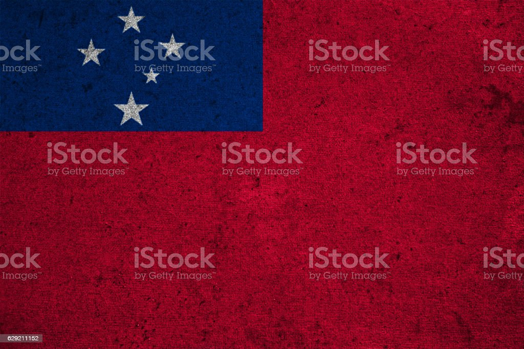 flag on an old grunge background stock photo