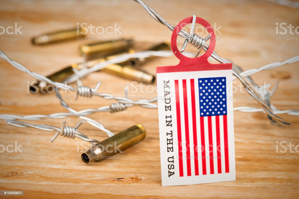 US flag on barbed wire stock photo
