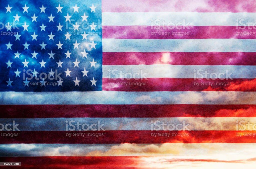 USA flag on cloudy sky stock photo