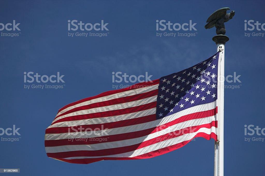 USA Flag on eagle flagpole royalty-free stock photo