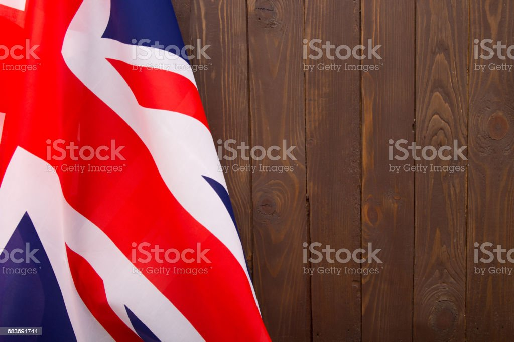 UK flag on wooden background.The place to advertise, template. stock photo