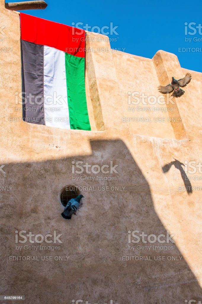 UAE flag outside a tradional building in Dubai Old Town. stock photo