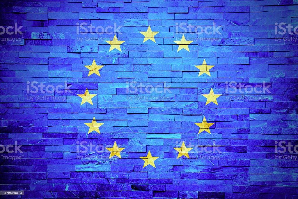 EU flag painted on a brick wall stock photo