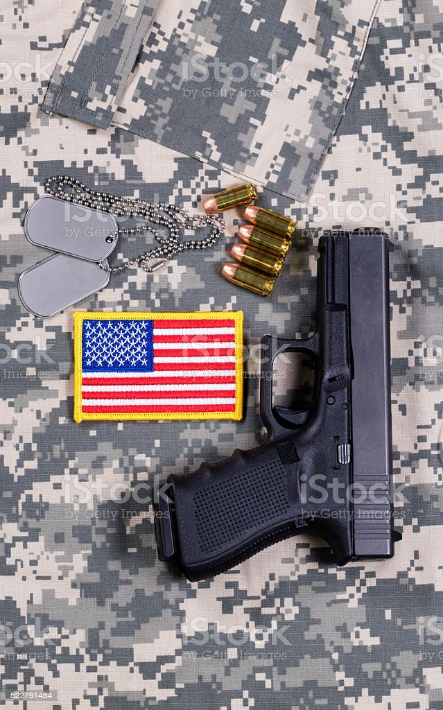 USA Flag patch on military uniform with weapon and ammo stock photo