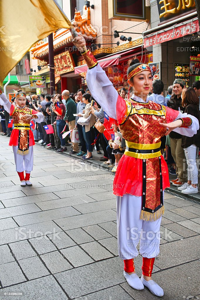 Flag Performance on the Street of Yokohama Chinatown stock photo