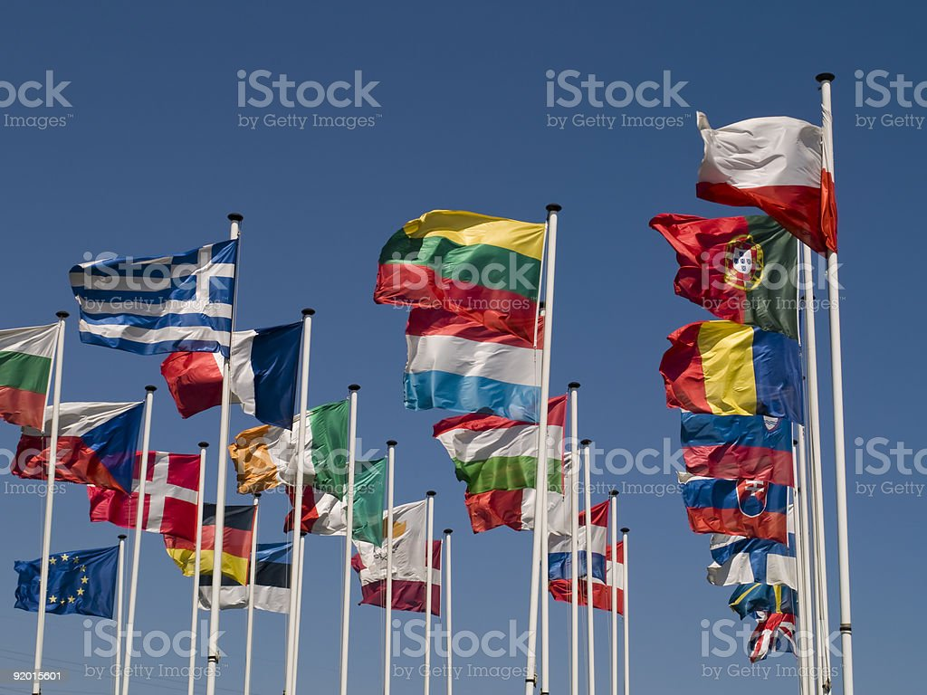 Flag poles with various country flags stock photo