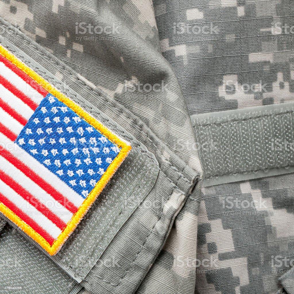 US flag shoulder patch on military uniform - studio shot stock photo