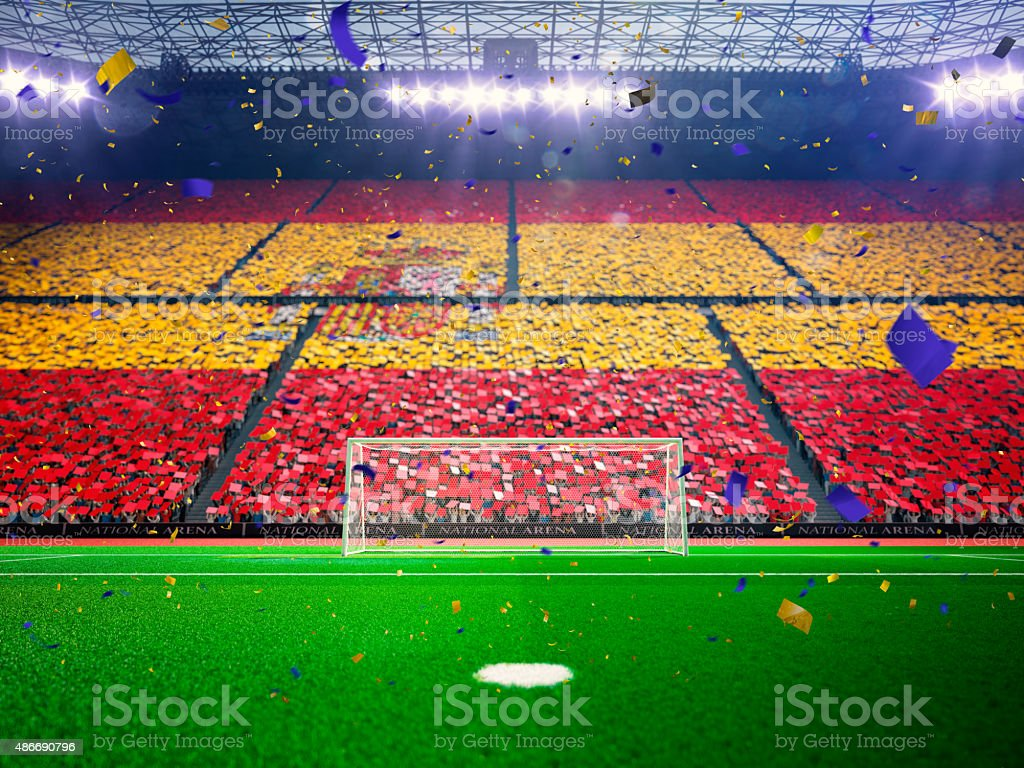 Flag Spain  of fans. Evening stadium arena Blue stock photo