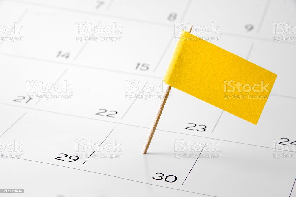 Flag the event day or deadline on calendar 2016 stock photo