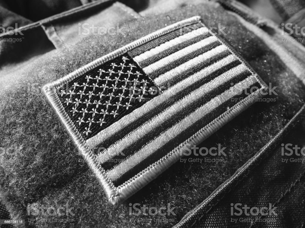 US flag velcro patch on the bulletproof vest, black and white, shallow depth of field. stock photo