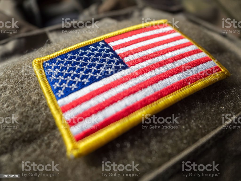 US flag velcro patch on the bulletproof vest, shallow depth of field stock photo