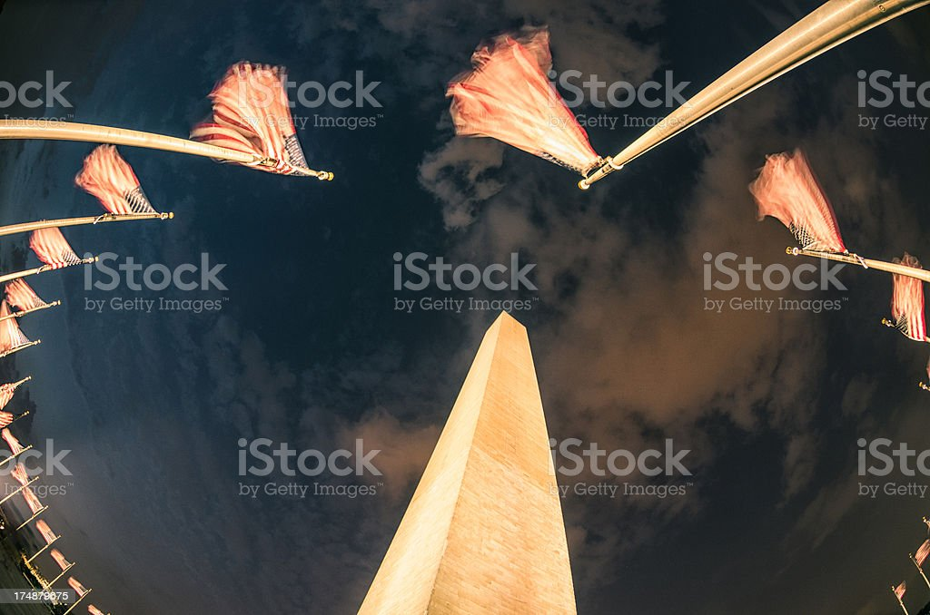 USA flag wavings at the Washington Monument royalty-free stock photo