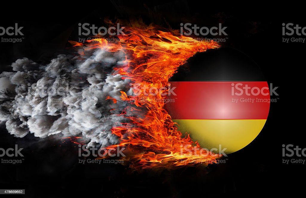 Flag with a trail of fire and smoke - Germany stock photo