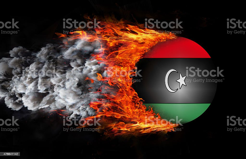 Flag with a trail of fire and smoke - Libya stock photo
