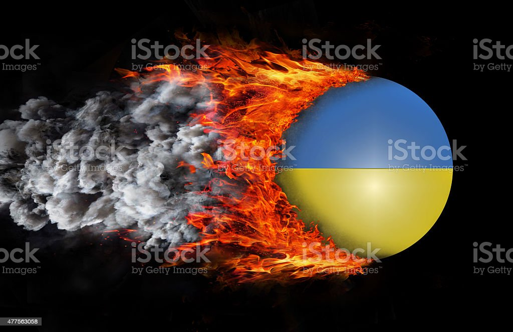 Flag with a trail of fire and smoke - Ukraine stock photo