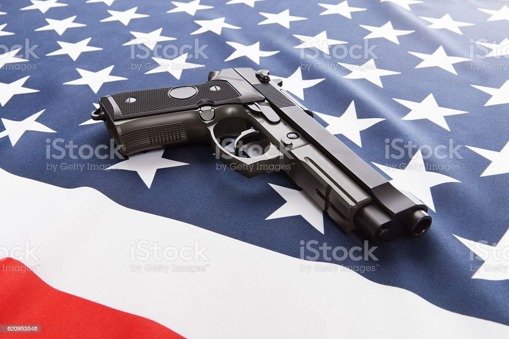 Flag with hand gun over it series - USA stock photo