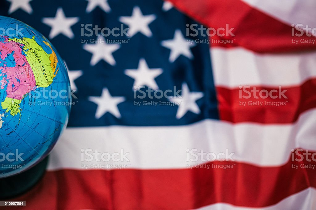 US flag with map of the world stock photo