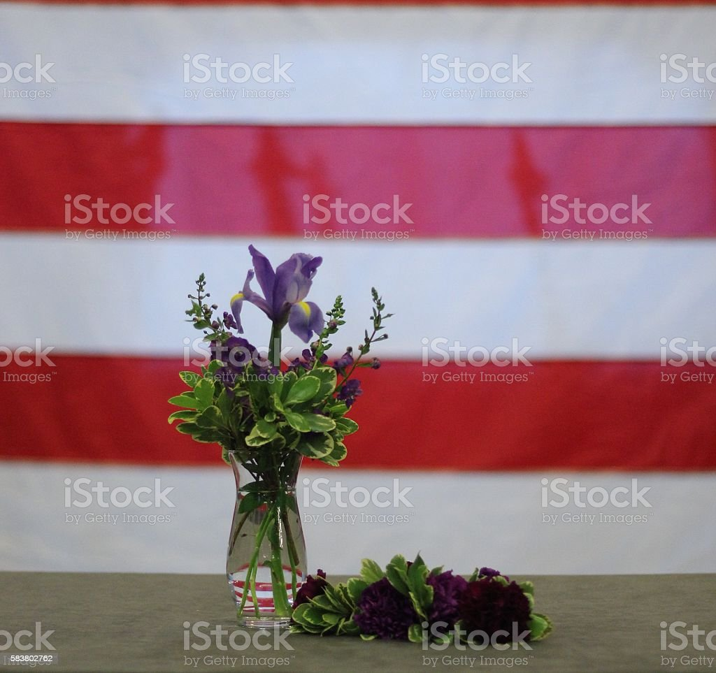US Flag with Purple flowers in Vase - Stock stock photo
