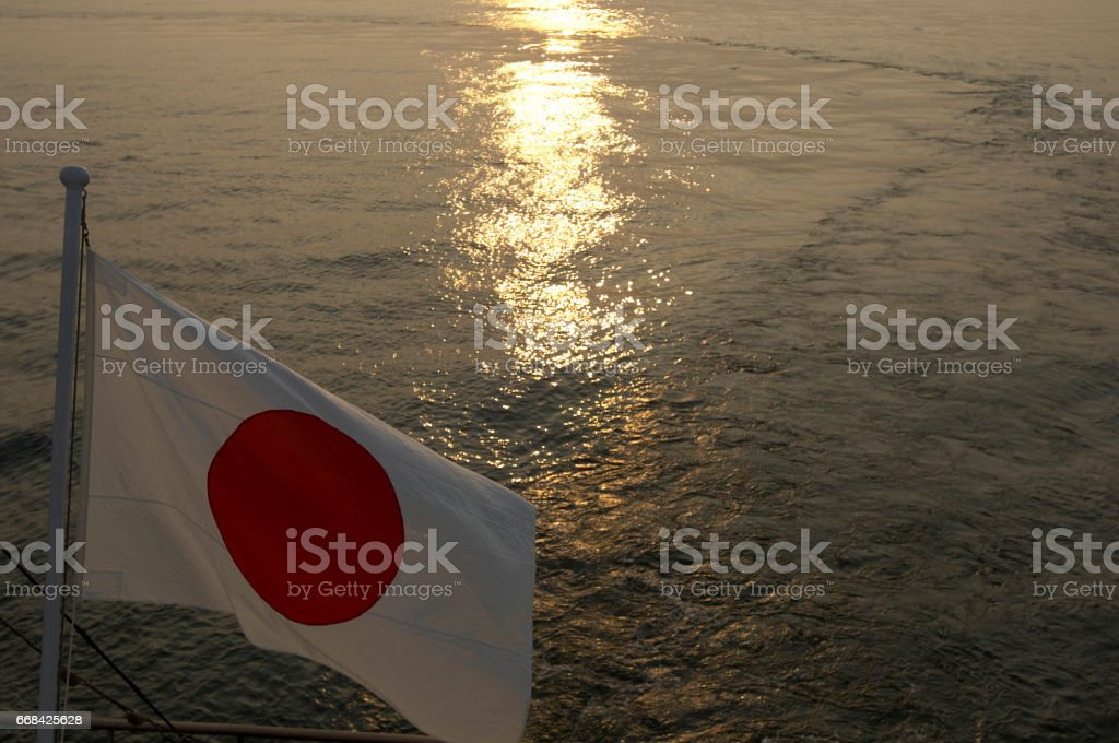 Flag with sea and sunset stock photo