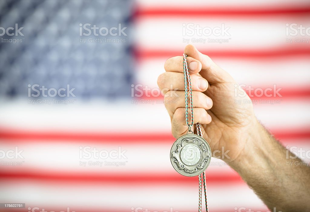 US flag with the winner second place silver medal royalty-free stock photo