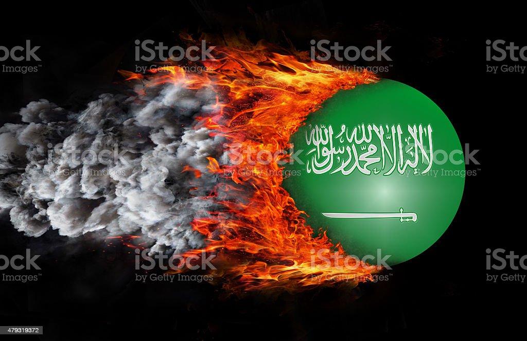 Flag with trail of fire and smoke - Saudi Arabia stock photo