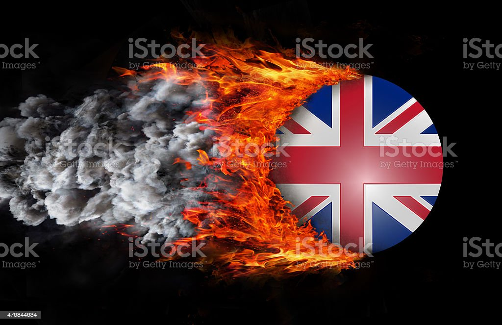 Flag with trail of fire and smoke - United Kingdom stock photo