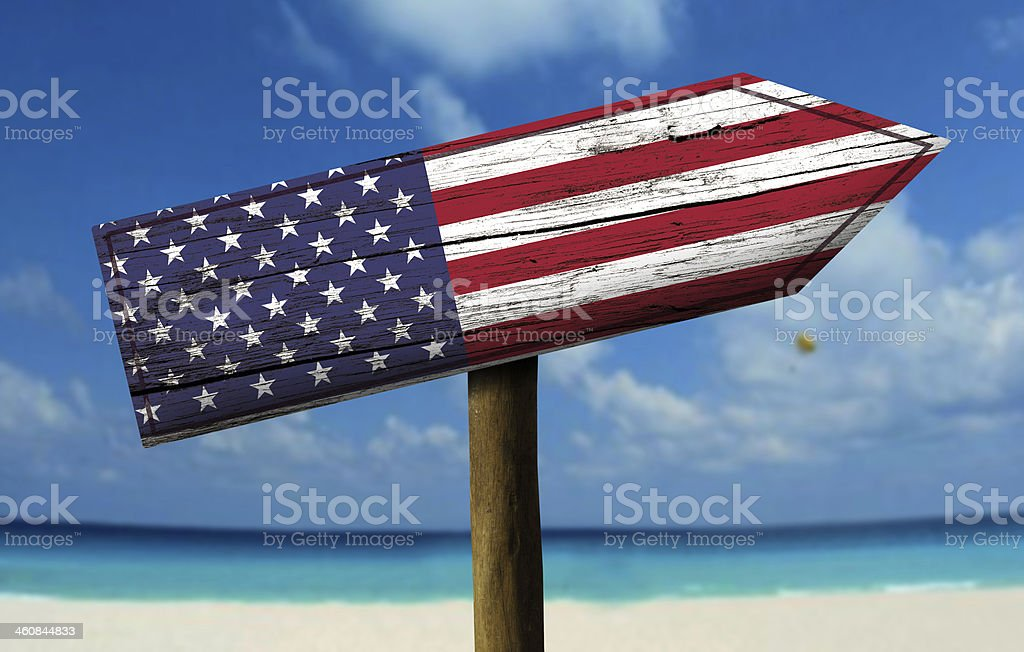 USA flag wooden sign with a beach on background stock photo