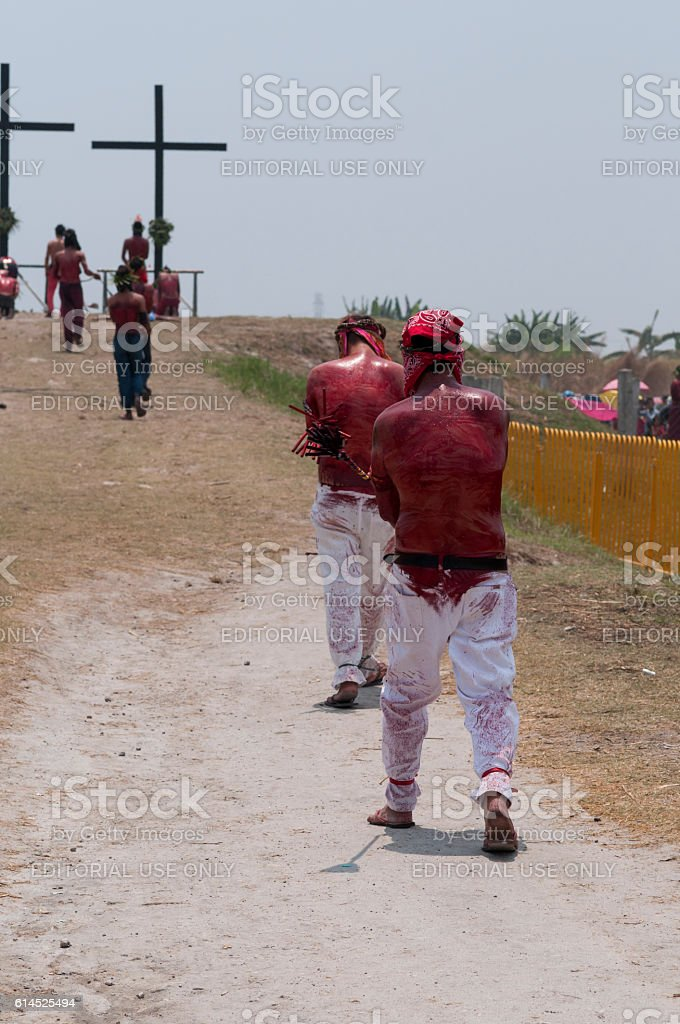Flagellants who mortify themselves stock photo