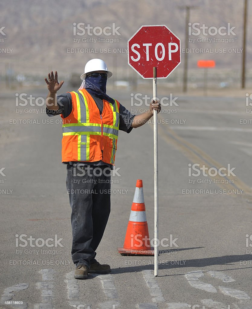 Flagger with Stop Sign stock photo
