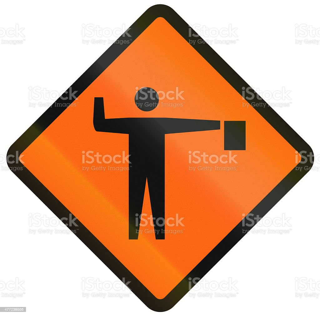 Flaggers In Road Ahead In Indonesia stock photo