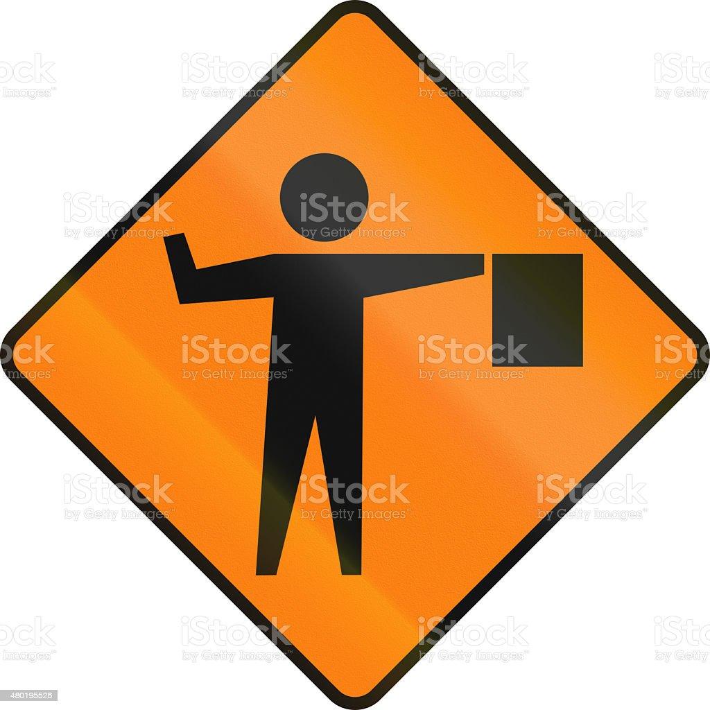 Flaggers In Road Ahead In Ireland stock photo