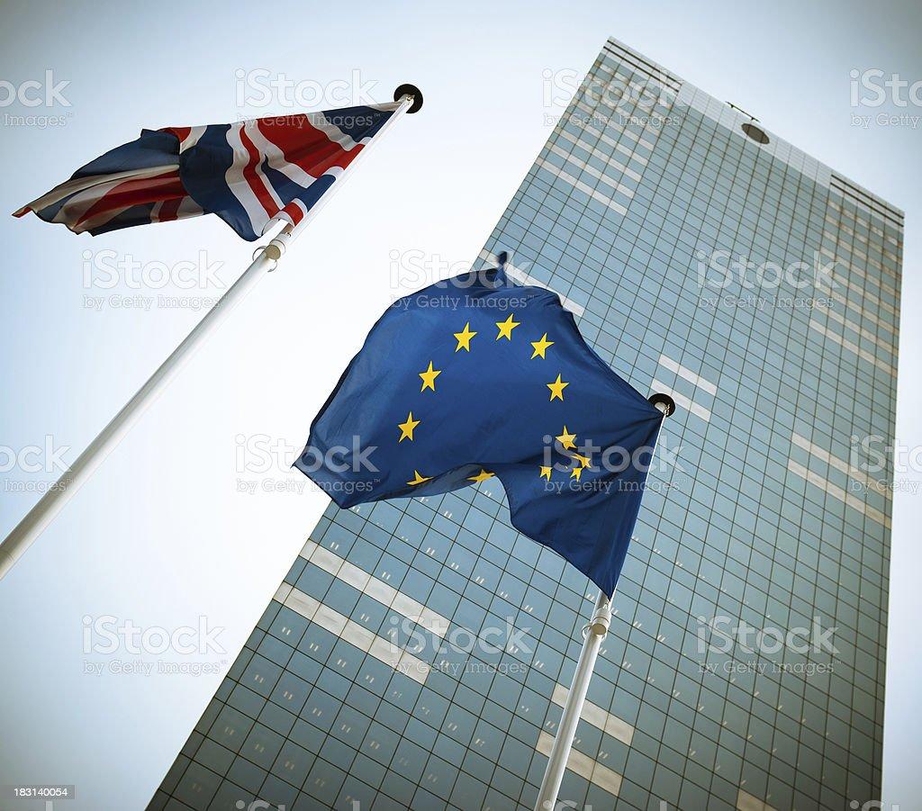 Flags against European skyscraper Parliament in Brussels stock photo