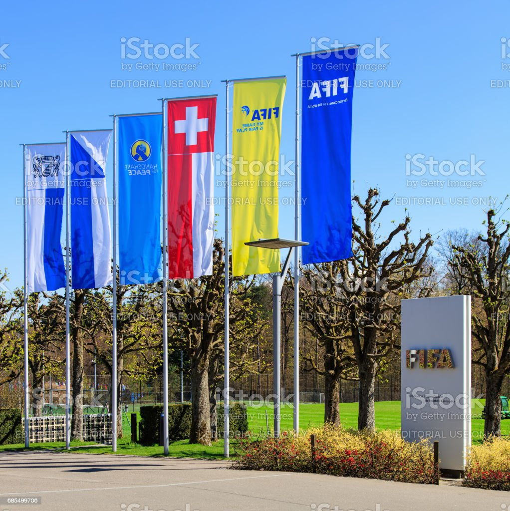 Flags and a stele at the entrance to the FIFA headquarters in Zurich, Switzerland stock photo