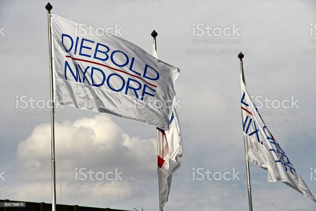flags and banners of Wincor Diebold company, Paderborn, Germany stock photo