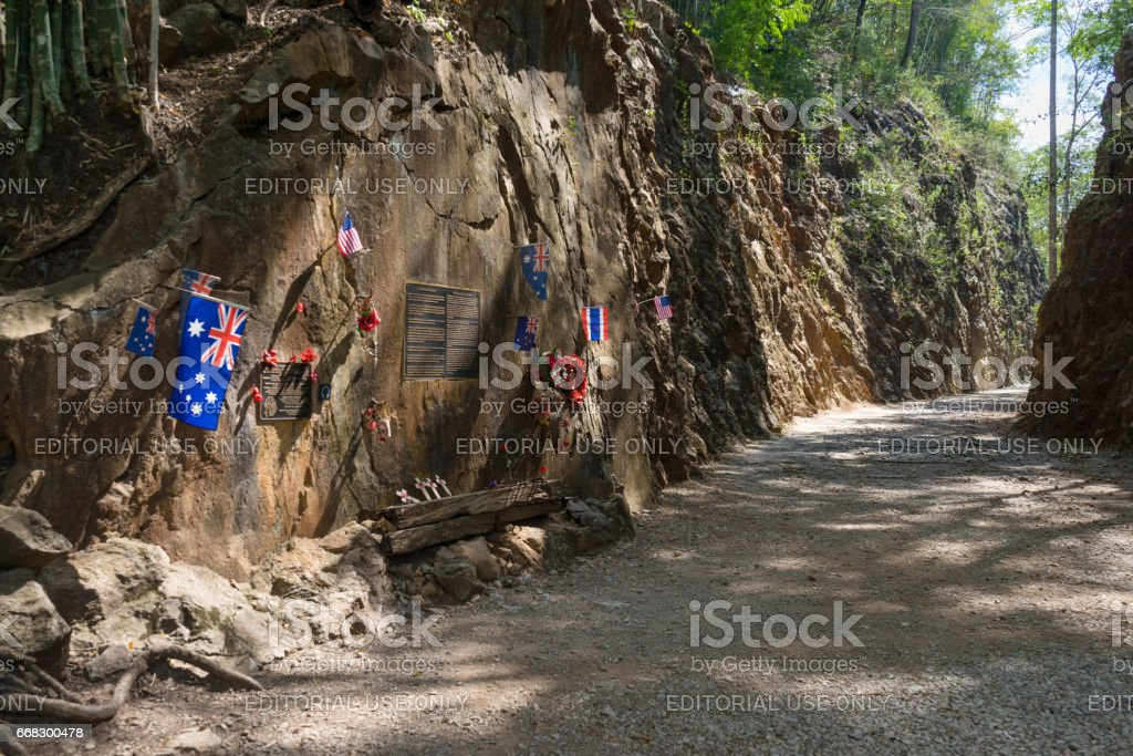 Flags and metal plates on rocky cliff at Hellfire Pass stock photo