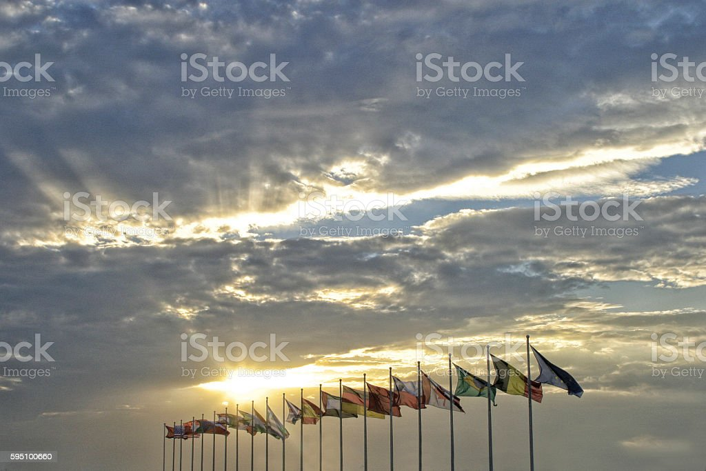 Flags and sunset stock photo